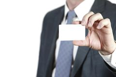 Business card. Businessman holding an empty business card. Isolated on white Royalty Free Stock Photo