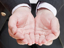 Businessman holding empty handful from two palms Royalty Free Stock Image
