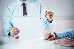 Businessman Holding Empty Notebook with Copy Space Royalty Free Stock Image