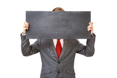 Businessman holding empty sign Stock Images