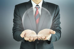 Businessman holding empty transparent ball Stock Images