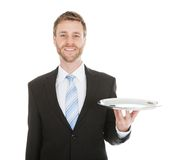 Businessman holding empty tray over white background Stock Photo