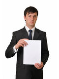 Businessman holding empty white card. Isolated on white background Royalty Free Stock Photography
