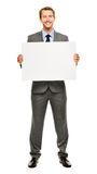 Businessman holding empty white placard showing copy space Royalty Free Stock Images
