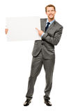 Businessman holding empty white placard showing copy space Royalty Free Stock Image