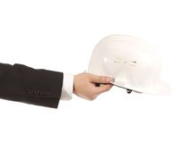 Businessman holding an engineer helmet Royalty Free Stock Images