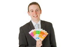 Businessman holding euro banknotes Royalty Free Stock Photos