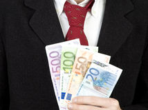 Businessman holding euro bills Royalty Free Stock Images