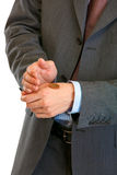 Businessman holding euro coin on hand. Close-up. Royalty Free Stock Photos