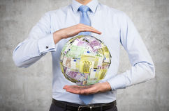 Businessman holding euro money ball Royalty Free Stock Photo