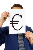 Businessman is holding euro sign Stock Photography
