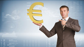 Businessman holding euro sign. Blue gradient Royalty Free Stock Images
