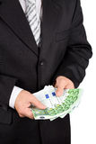 Businessman holding euros Stock Photo