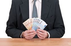 Businessman holding Euros cash Royalty Free Stock Images