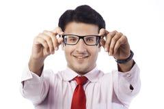 Businessman holding eyeglasses Royalty Free Stock Image