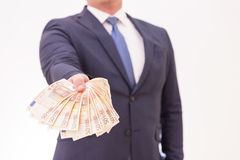 Businessman holding fifty Euro banknotes in his hands, giving to somebody Royalty Free Stock Photography