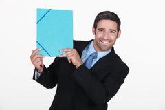 Businessman holding file Royalty Free Stock Image
