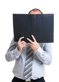 Businessman holding file pad and cover his face Stock Image