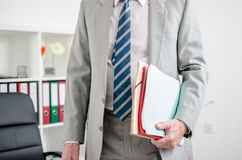 Businessman holding files Stock Image