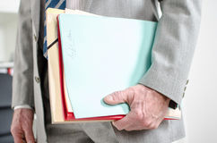 Businessman holding files Royalty Free Stock Photos