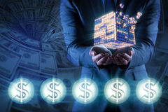 The businessman holding financial cube in business concept Stock Photos