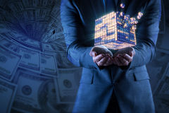 The businessman holding financial cube in business concept Stock Photo