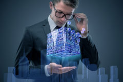 The businessman holding financial cube in business concept Stock Photography
