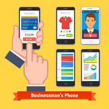 Businessman holding and finger tapping his phone Stock Photography