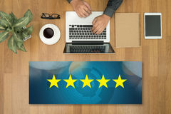 Businessman holding five star rating, Review, increase rating or. Ranking, evaluation and classification concept royalty free stock images