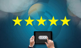 Businessman holding five star rating,Review, increase rating or