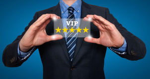 Businessman holding five star rating VIP - Blue - Stock Image royalty free stock photo