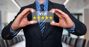 Businessman holding five star rating VIP - Office - Stock Image royalty free stock image