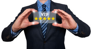 Businessman holding five star rating VIP - White - Stock Image royalty free stock image