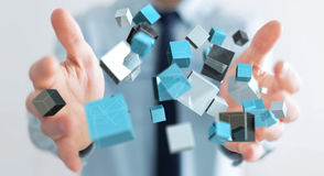 Businessman holding floating blue shiny cube network 3D renderin Royalty Free Stock Photos