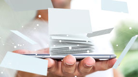 Businessman holding floating business card 3D rendering. Businessman holding white floating business card in his hand 3D rendering Stock Photo