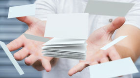 Businessman holding floating business card 3D rendering. Businessman holding white floating business card in his hand 3D rendering Stock Image