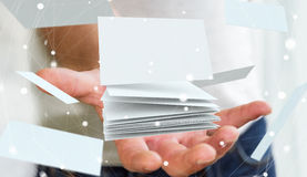 Businessman holding floating business card 3D rendering. Businessman holding white floating business card in his hand 3D rendering Royalty Free Stock Photography