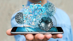 Businessman holding flying abstract sphere over mobile phone 3D. Businessman on blurred background holding flying abstract sphere over mobile phone 3D rendering Royalty Free Stock Images