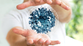 Businessman holding flying abstract sphere with shiny cube 3D re Stock Image