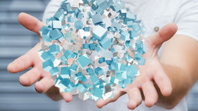 Businessman holding flying abstract sphere with shiny cube 3D re. Businessman on blurred background holding flying abstract sphere with shiny cube 3D rendering Royalty Free Stock Photo