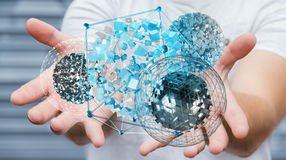 Businessman holding flying abstract sphere with shiny cube 3D re. Businessman on blurred background holding flying abstract sphere with shiny cube 3D rendering Stock Photo