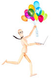 Businessman holding flying balloons and laptop Royalty Free Stock Photos