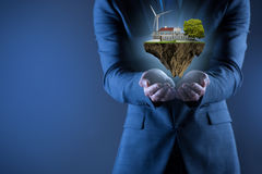 The businessman holding flying island in eco concept Royalty Free Stock Photography