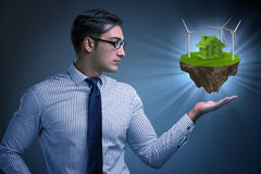 The businessman holding flying island in eco concept Royalty Free Stock Image