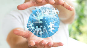 Businessman holding flying puzzle sphere '3D rendering' Royalty Free Stock Image