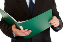 Businessman holding folder with documents. Closeup royalty free stock photography