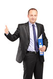 Businessman holding a folder and giving thumb up Royalty Free Stock Photos