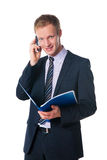 Businessman holding folder and talking on phone Royalty Free Stock Image