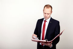 Businessman holding a folder  on white Royalty Free Stock Images
