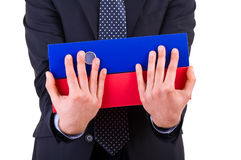 Businessman holding folders. Stock Image